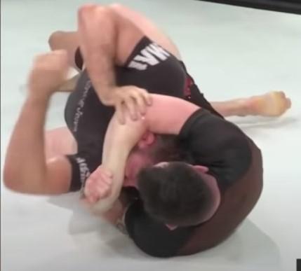 Craig Jones in Mason Fowler's body triangle and neck crank