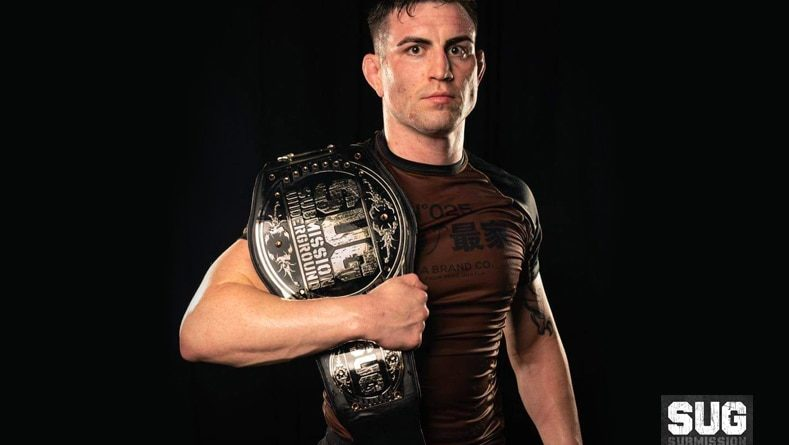 Mason Fowler with the Submission Underground belt.
